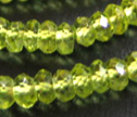 A Peridot Micro Faceted 4mm Rondelle Beads